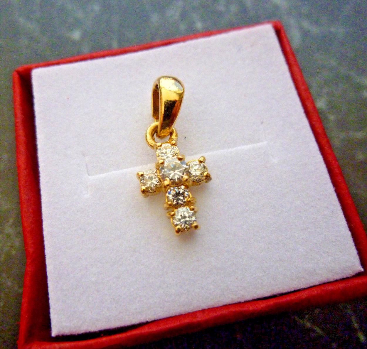 Pendentif  croix  or 18 K serti de zirconiums  poincon  750