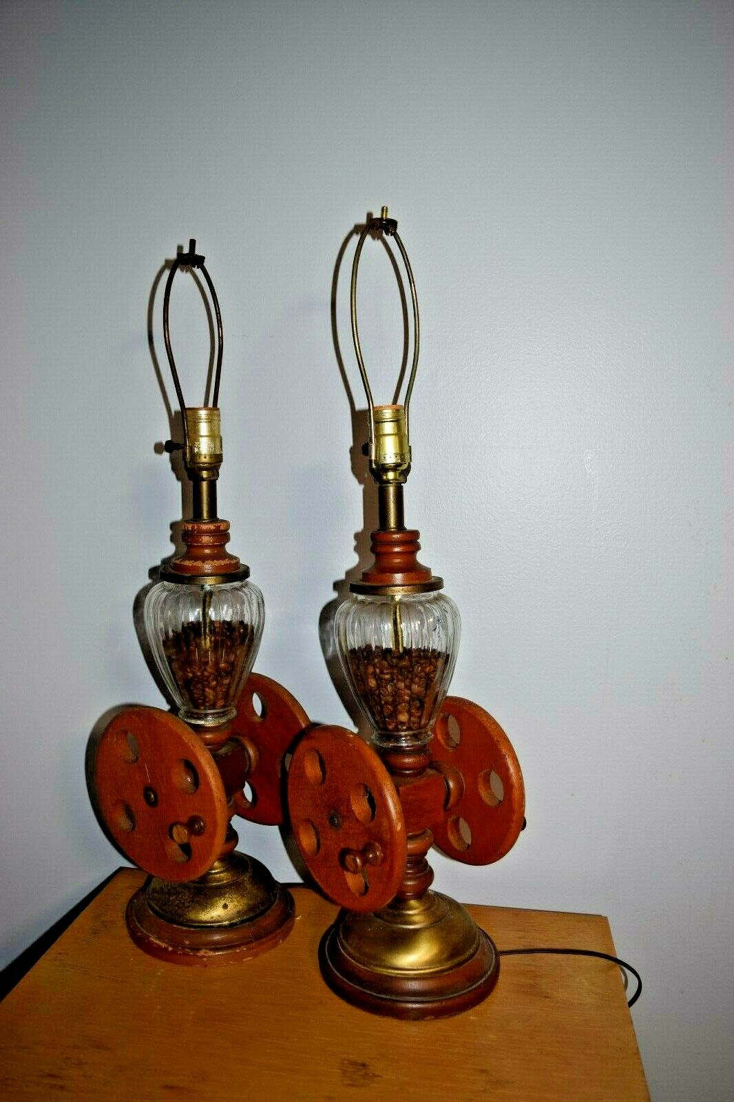 Vintage Pair Wood and glass Coffee Grinder table lamp with coffee beans inside.