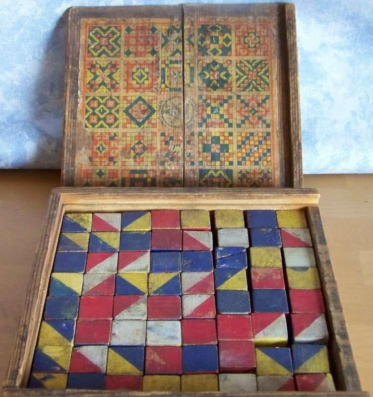 Altes Holzpuzzle mit 64 Würfel und 25 Motiven / Fabrik Merke S F