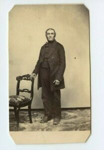 Vintage-CDV-Gentleman-standing-by-chair-by-Unknown-photographer-N73