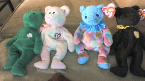 Four colectible Beanie Babies