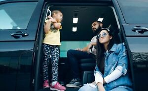 Family sitting in a van