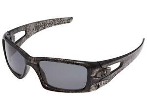 Oakley-Crankcase-Polarized-Sunglasses-OO9165-06-Grey-Smoke-History-Text-Grey