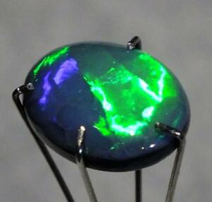 BLACK-OPAL-Green-Blues-Broad-pattern-flash-2-72cts-Oval-shape-from-Lighning-Ridg