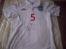 Rio Ferdinand signed England shirt with COA.