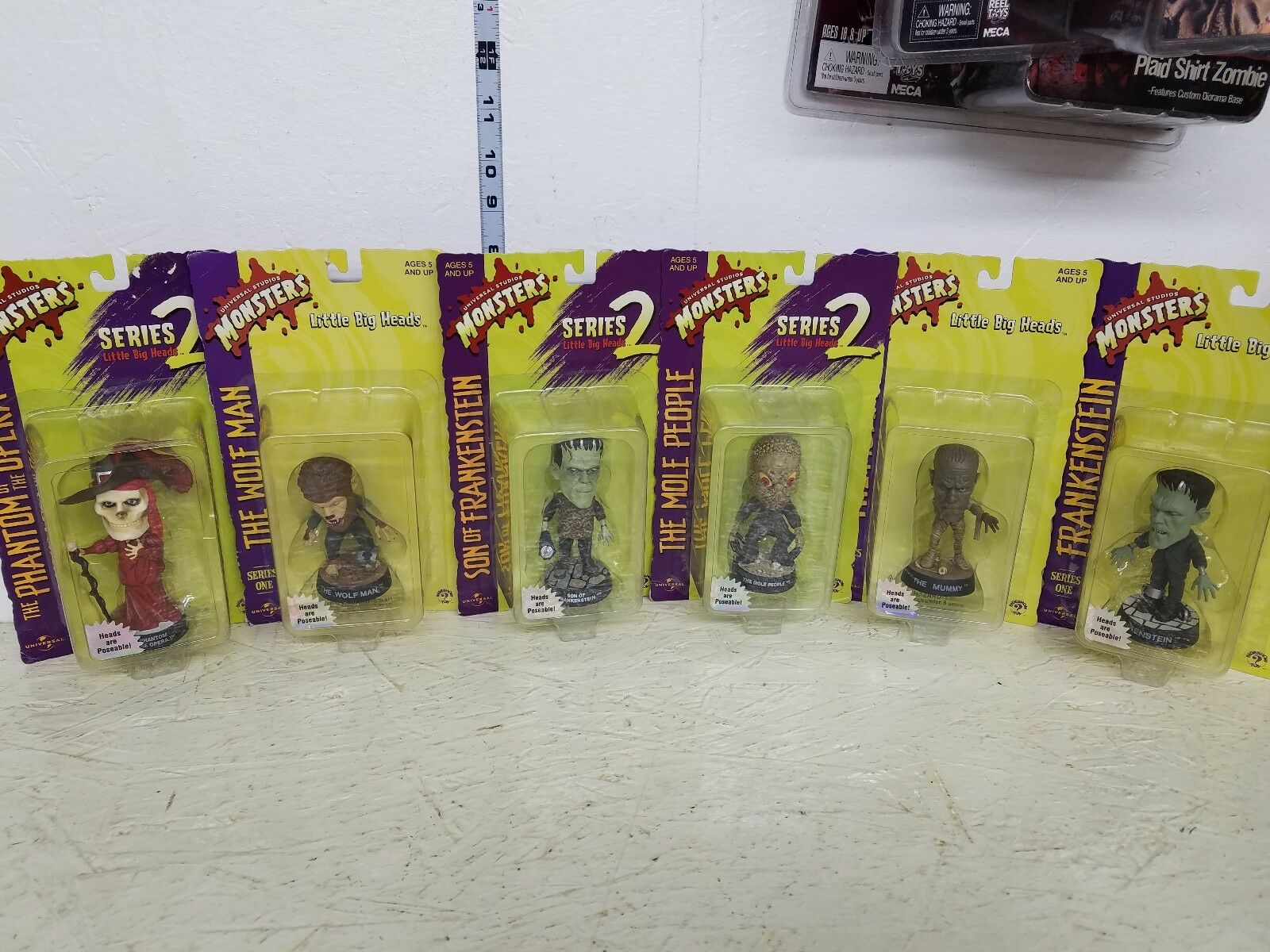 Universal Studios Little Big Heads Set of 6 Figures on the card