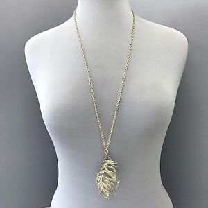 Trendy long antique gold finish unique feather shaped design pendant image is loading trendy long antique gold finish unique feather shaped aloadofball Choice Image