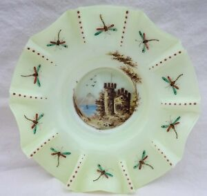 """Austria Art Glass Opaline Uranium Glass Decorative Plate 1860 - France - Commentaires du vendeur : """"Rare scalloped uranium oplaine glass plate made in Austria around 1960. The enamel hand painted decor shows a castle in the mounts on the lakeside and dragonflies and pearls on the rim border. The crystal opaline plat - France"""
