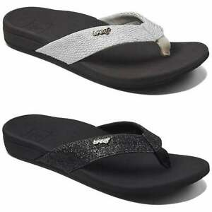 d9f221c8cbc1 Reef Women s Ortho Spring Flip Flops Black Glitter Brown White Vegan ...