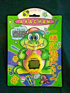 Orginal-Akachan-Tamagotchi-Dino-ca-80er-Jahre-Gelb-DM-Vintage
