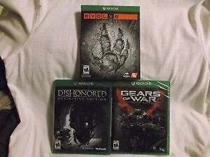X-Box-One-3-Games-Dishonored-Definitive-Ed-Evolve-Gears-of-War-Ultimate-Ed