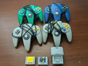 Lot of 4 N64 Controllers, a rumble pack and two memory cards - all orginal!