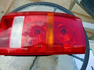 LANDROVER DISCOVERY 3 REAR LIGHT CLUSTER, GENUINE LANDROVER PART NEAR SIDE