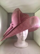 Ladies dressy derby sinemay hat. Big beautiful lavendar eye catcher. Fits firmly