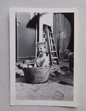 c1960 B/W Photograph. Little Boy Having a Backyard Bath. Tinplate Train. Pre-Fab