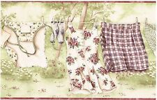 OLD TIME FANCY WOMENS CLOTHING ON CLOTHESLINE ON FIELD Wallpaper bordeR Wall