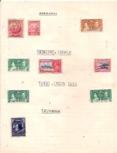9 old BARBADOS,TRINIDAD & TOBAGO,TURKS & CAICOS ISLES,TASMANIA on an album page.