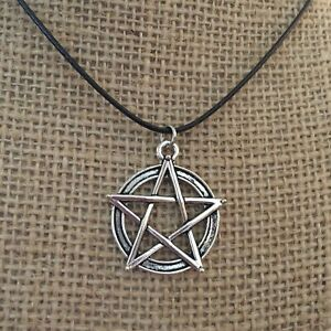 Black cord with silver pentacle charm necklace.