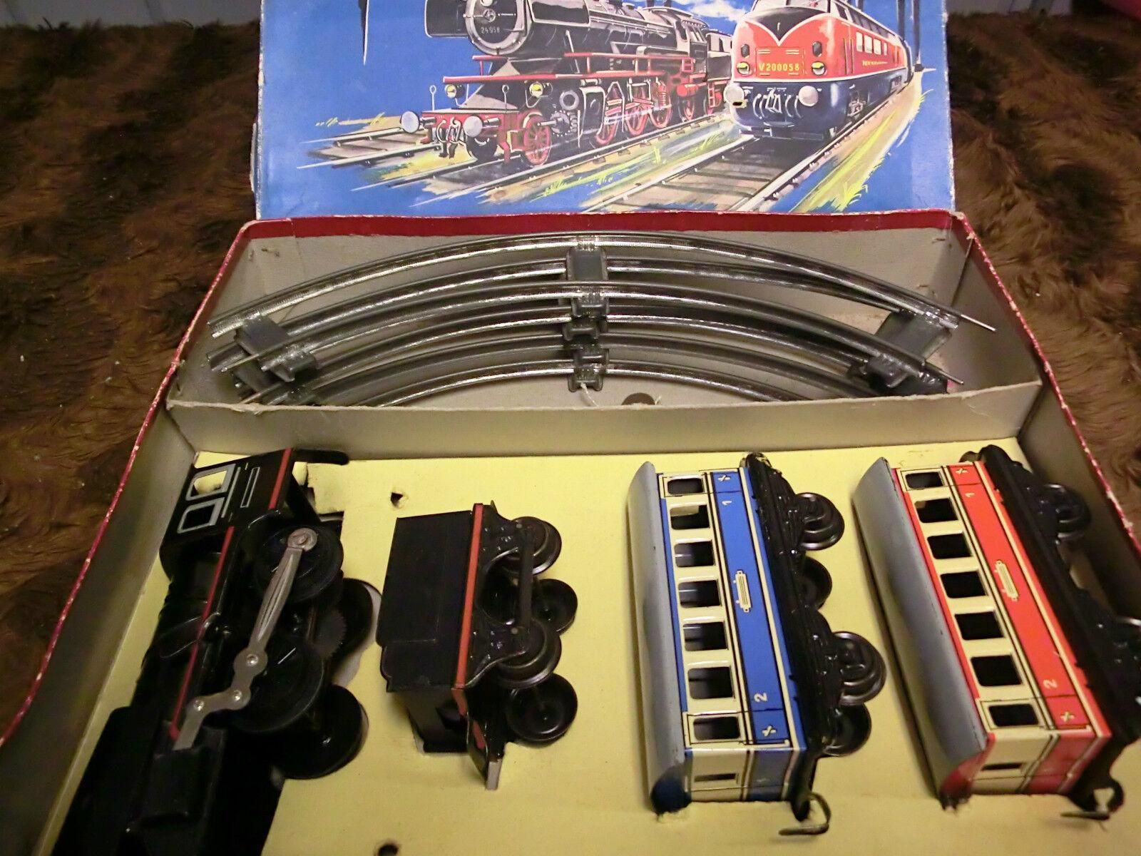Distler Modeleisenbahn Blechspielzeug Dampflok m. Tender m. 2 Wagen