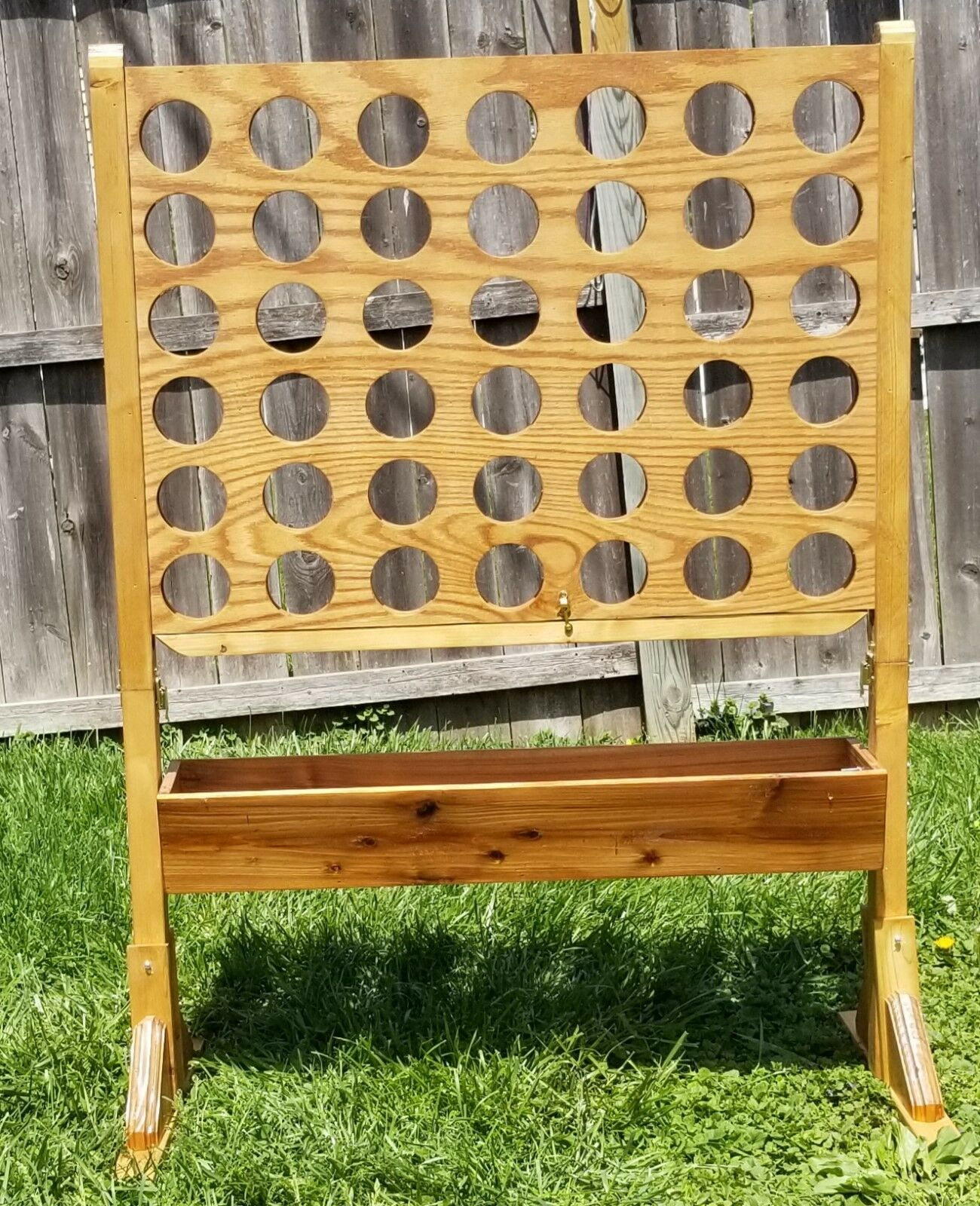 Giant connect 4 game with catch trough