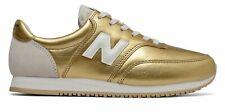New Balance de mujer Comp 100 zapatos de oro con tan
