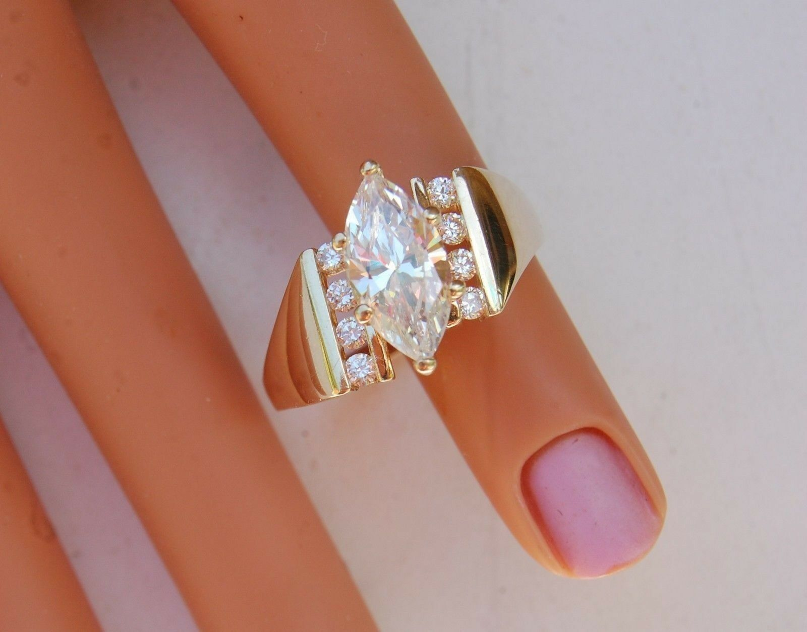 Solid 14k gold Ring CZ Marquise 12x6mm  Channel Set 8 Gems 5.4 gr Size 8 1 4