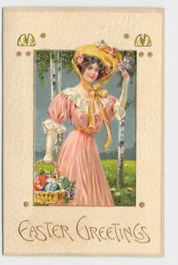 ANTIQUE-POSTCARD-EASTER-WOMAN-PINK-DRESS-YELLOW-HAT-BASKET-OF-EGGS-VIOLETS-EMBOS