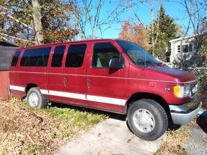 Extended 12 passenger Cab Van
