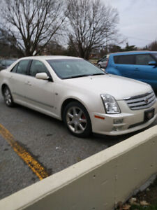 CADILLAC STS LOW MILLEAGE IN EXCELLENT COND.