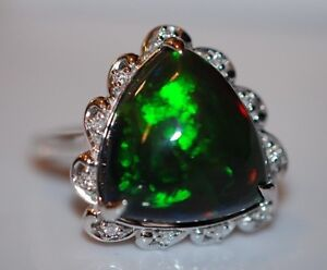 nwt 8 24 carat black opal surrounded by diamonds ring in
