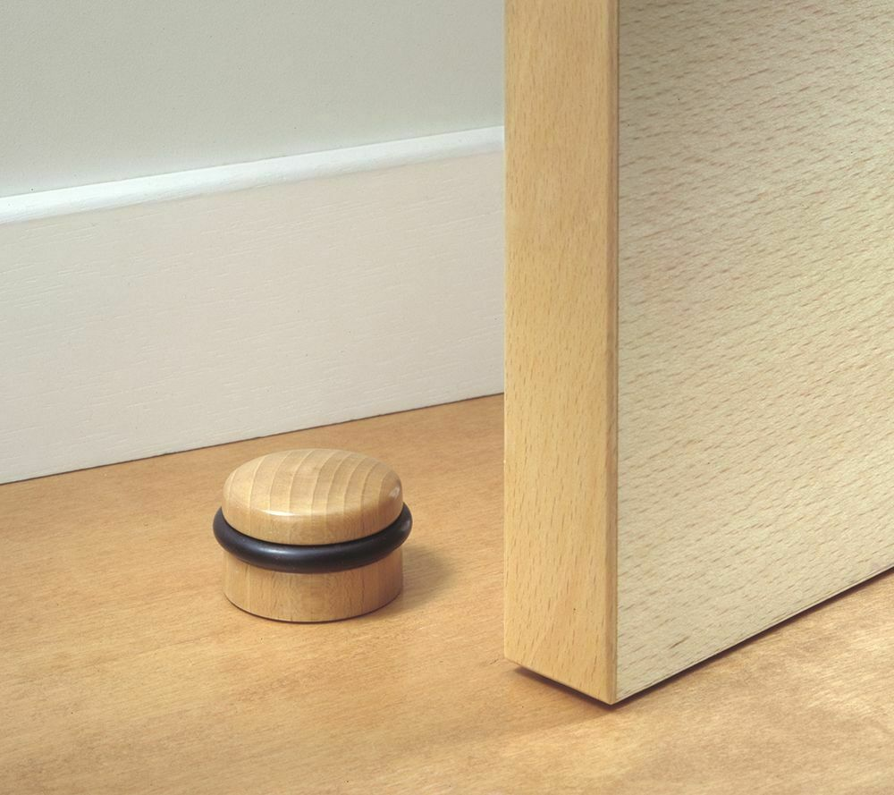 Black white patterned. White wooden door stop with ceramic knob