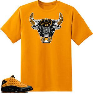 bf0911afc22 Shirt to match Air Jordan Retro 13 Chutney Sneakers. Bull 13 Gold ...