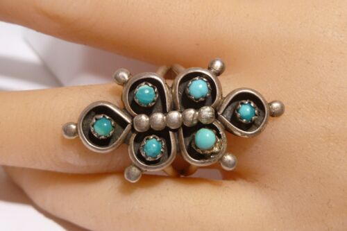 a Navajo silversmith with Kingman turquoise ON SALE Turquoise repousse ring handmade and signed in sterling silver 925 by Tim Yazzie
