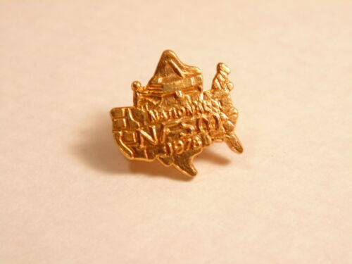 Gold colored National Fraternity of Student Musicians 1978 pin