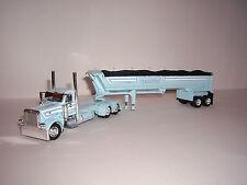 DCP 1/64 LINDAMOOD PETERBILT 389 DAY CAB WITH MAC HALF ROUND DUMP TRAILER