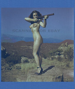 Nude girl with a gun