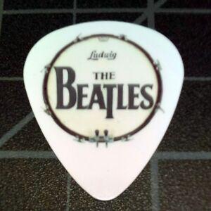 the beatles drum head novelty logo guitar picks set of 4 ebay. Black Bedroom Furniture Sets. Home Design Ideas