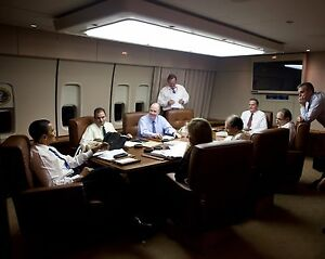 President-Barack-Obama-meets-with-staff-aboard-Air-Force-One-Photo-Print
