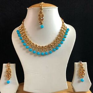 Turquoise and gold necklace and earrings