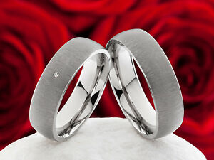 Partnerringe-Eheringe-Trauringe-aus-Titan-mit-0-01ct-Diamant-Lasergravur-P313