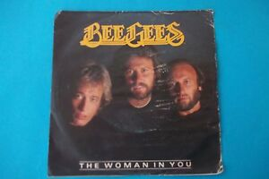BEE-GEES-THE-WOMAN-IN-YOU-STAYING-ALIVE-45-GIRI-1983-POLYGRAM-NUOVO