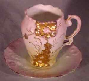 Antique Demitasse Cup and Saucer Heavily Embossed