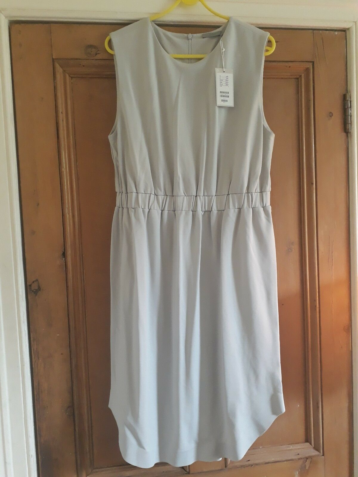 COS sleeveless dress with an elasticated waist  size L. New with tags.