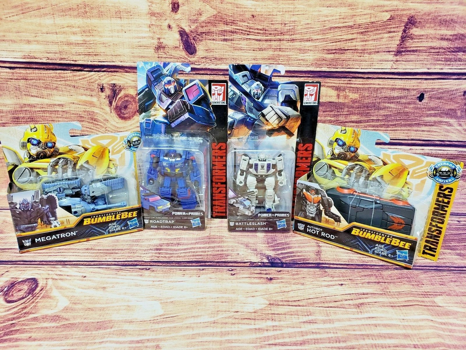 Transformers lot of 4 hot rod, battleslash, roadtrap, megatron, action figures