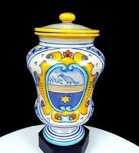 "GRAZIA DERUTA SIGNED ITALIAN ART POTTERY CREST DESIGN LIDDED 8 1/2"" JAR"