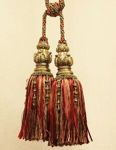 A pair of Wooden Carved-DoubleTie BackTassel Maroon with multi color string