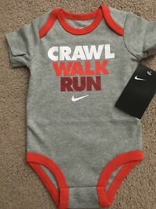 69b8b3394c4614 NWT Infant Baby Nike Gray Crawl Walk Run Swoosh Logo One Piece ...