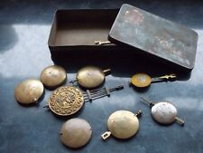 Clock pendulums in tin.