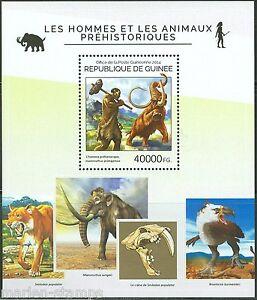 Guinee-2014-homme-prehistorique-et-animaux-SOUVENIR-SHEET-Comme-neuf-jamais-a-charniere