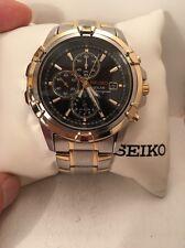 Seiko Men's Solar Chronograph Black Dial Two Tone Watch SSC142-HG